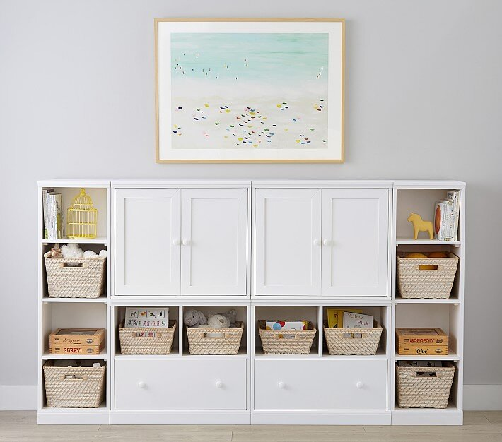 """- One day when you turn around and have the thought """"where did all these toys come from?"""" it's at that time you'll need a toy storage plan. This modular system from Pottery Barn is super cute and customizable for your needs!"""